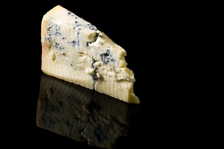 a wedge of gorgonzola cheese