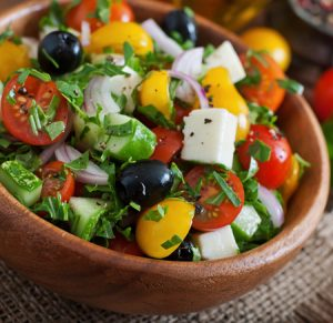 photo of Greek salad with feta cheese and black olives