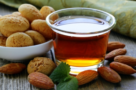 amaretto liqueur with amaretti biscuits and shelled almonds